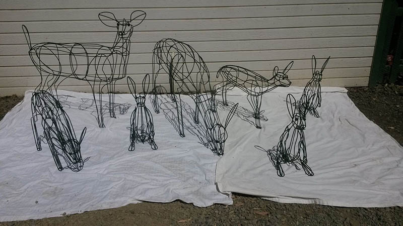 family of deer's, does and rabbits topiary frames
