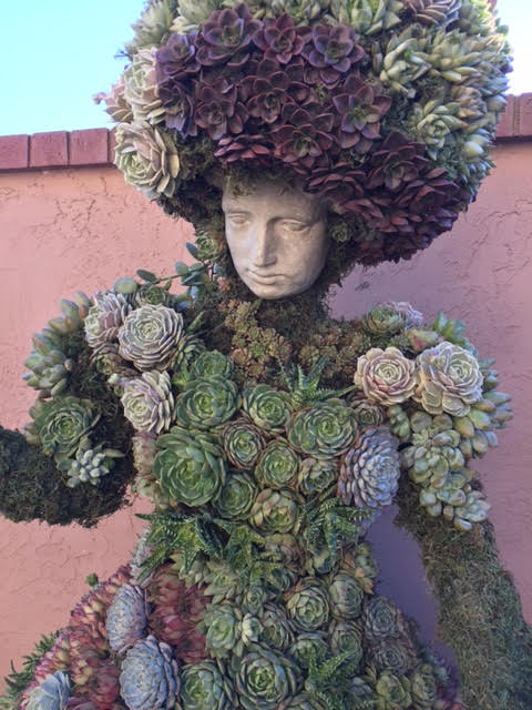 custom made topiary with floral blanket of shrubs, succulents and moss